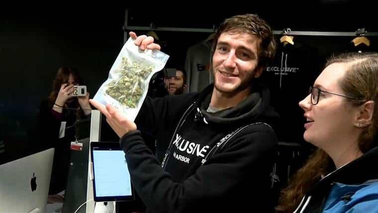 man buying marijuana in michigan
